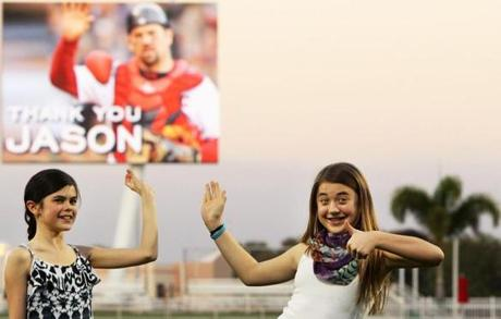 Daughters Kendall (left) and Alexandra got the message as their dad was hailed at JetBlue Park.
